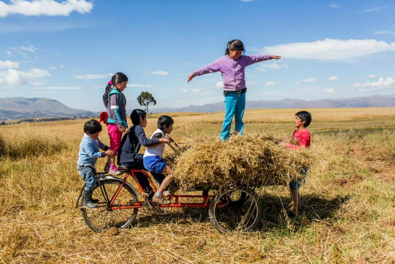 kids in a field Sacred Valley Sol y Luna Hotel Association Peru
